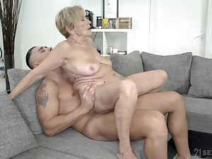 Wrinkled and saggy granny up to the eyes a fat cock