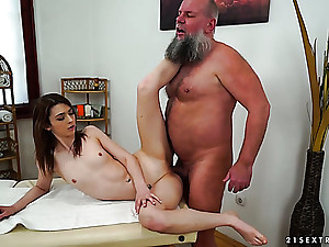 This old fart is one older masseur and he gets to fuck a sexy coed
