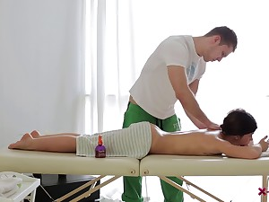 Masseur feeds his cock to her tight asshole on the game table