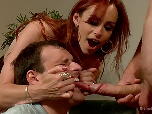 Dominant redhead shares slave's dick with the brush hubby in a rough trine
