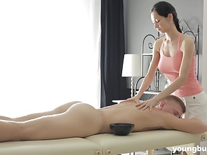 Slender masseuse with big titties Emma L gets intimate with one of her clients